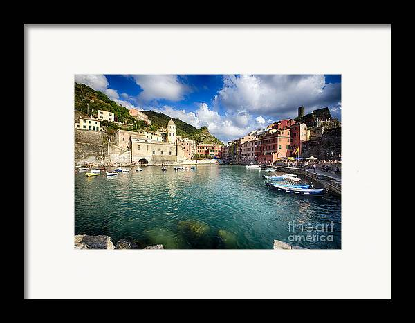 Cinque Terre Framed Print featuring the photograph Low Angle View Of Vernazza Harbor by George Oze
