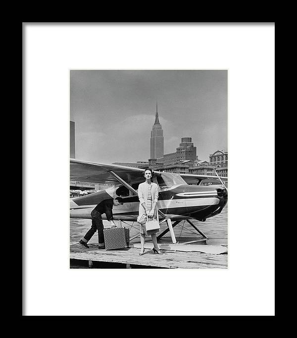 Two People Framed Print featuring the photograph Lucille Cahart With Small Plane In Nyc by John Rawlings