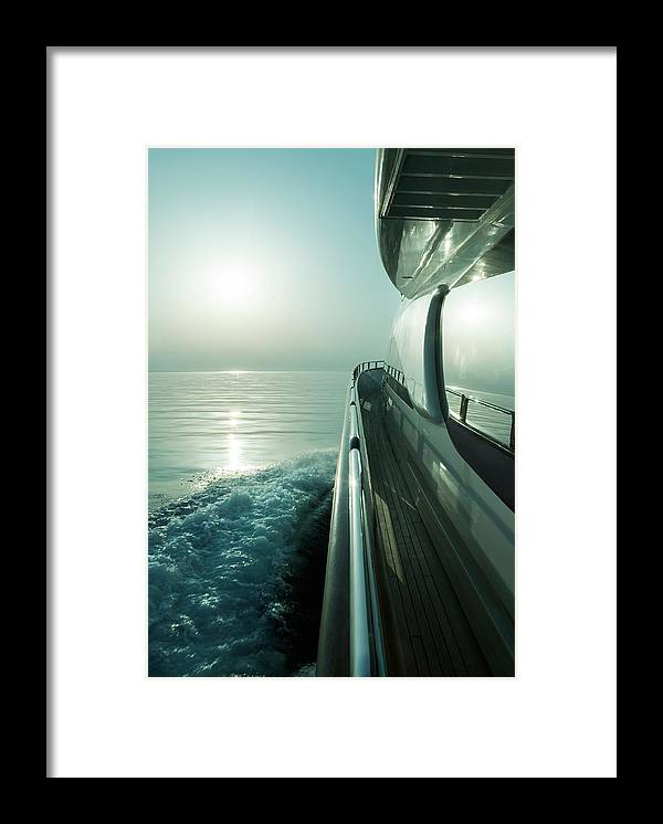 Desaturated Framed Print featuring the photograph Luxury Motor Yacht Sailing At Sunset by Petreplesea