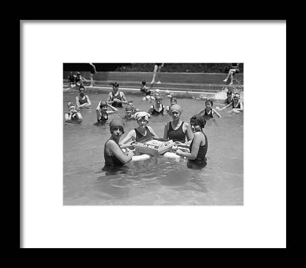 1920s Framed Print featuring the photograph Mah-jong In The Pool by Underwood Archives