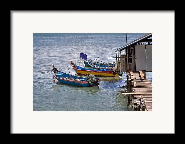 Travel Framed Print featuring the photograph Malaysian Fishing Jetty by Louise Heusinkveld