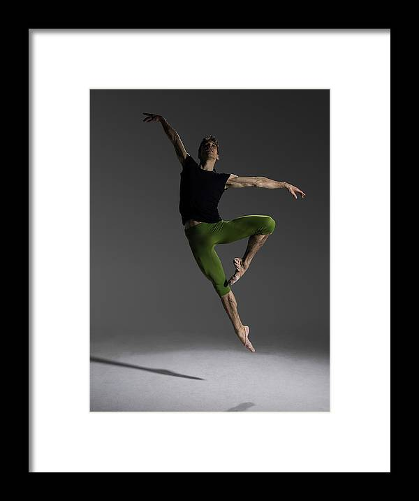 Ballet Dancer Framed Print featuring the photograph Male Ballet Dancer Jumping In Passé by Nisian Hughes