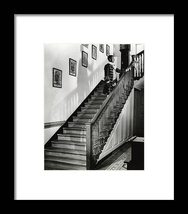 Antique Framed Print featuring the photograph Man Dressed As Colonial Butler On The Stair by George Karger