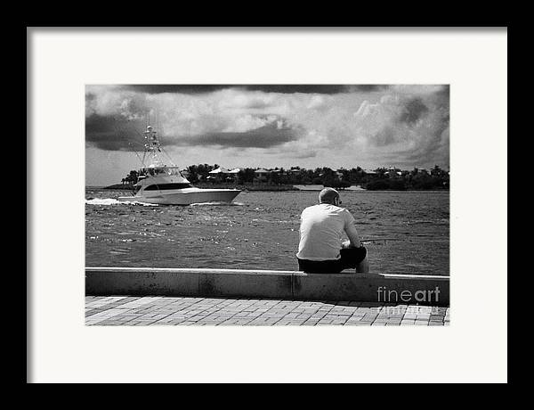 Man Framed Print featuring the photograph Man Fishing On Mallory Square Seafront Key West Florida Usa by Joe Fox