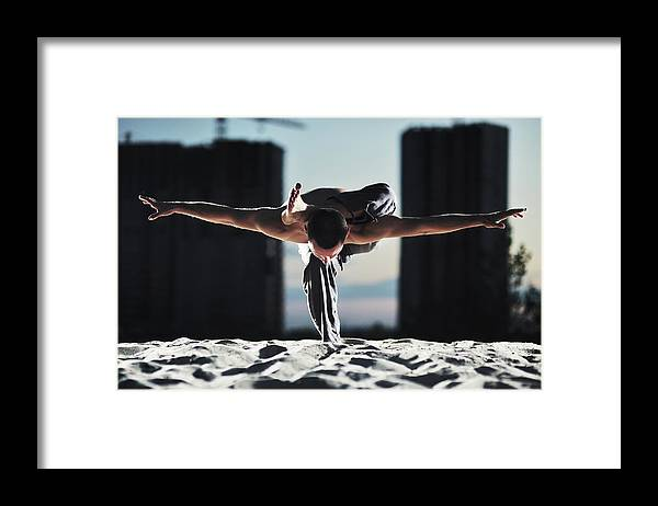People Framed Print featuring the photograph Man Holding Yoga Pose In The Sand by Myshkovsky