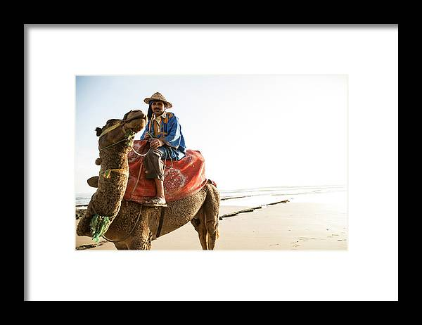 Agadir Framed Print featuring the photograph Man On Camel On Beach, Taghazout by Tim E White