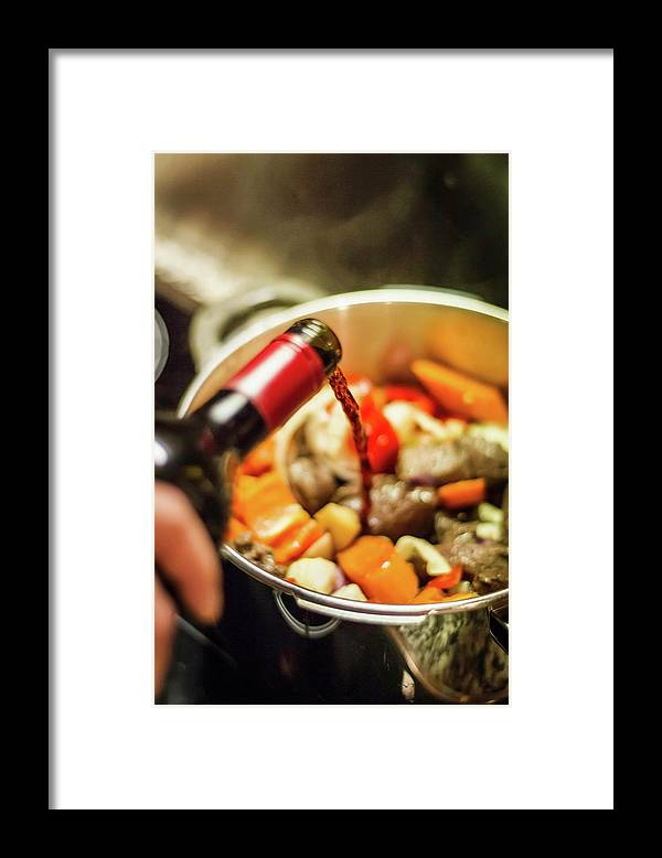 Mature Adult Framed Print featuring the photograph Man Pouring Wine Into Vegetables by Manuel Sulzer