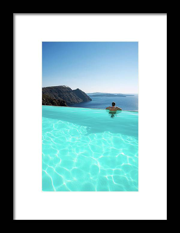 People Framed Print featuring the photograph Man Relaxing Looking At Santorini by Peskymonkey