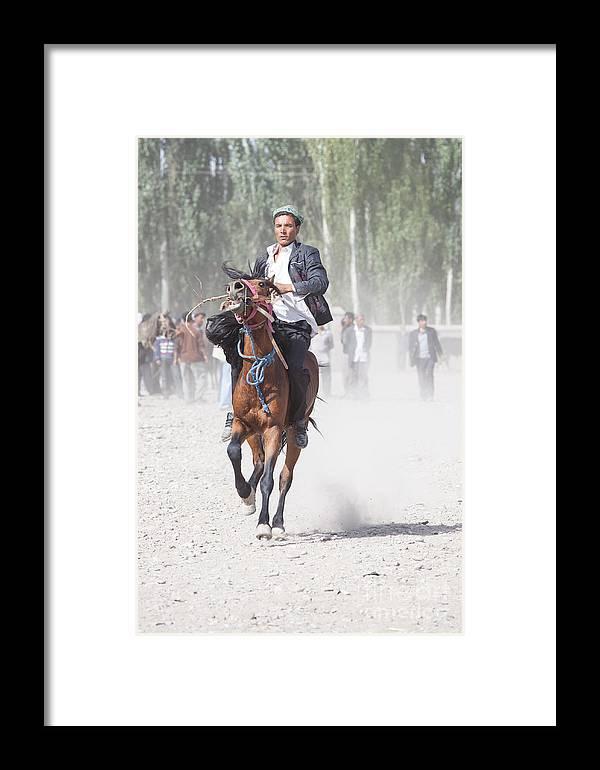China Framed Print featuring the photograph Man Riding A Horse At Kashgar Sunday Market China by Matteo Colombo