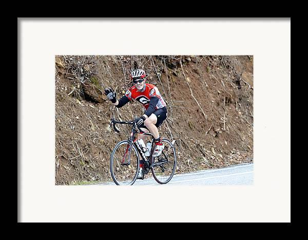 Sport Framed Print featuring the photograph Man Riding Bike In A Race by Susan Leggett