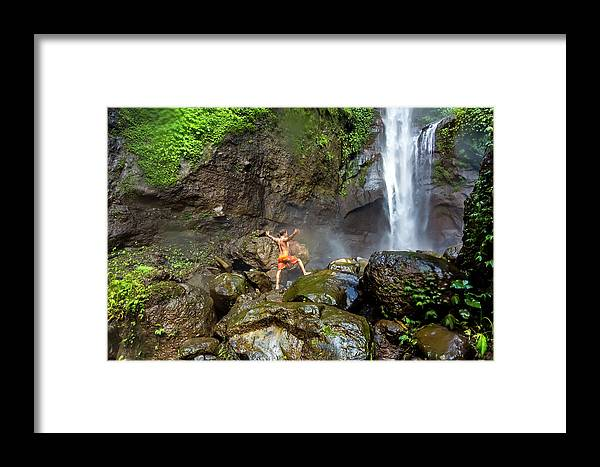 Waterfall Framed Print featuring the photograph Man Standing On Rocks Near Waterfall by Konstantin Trubavin