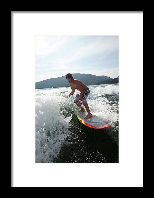 20-24 Years Framed Print featuring the photograph Man Wakesurfing Behind Wakeboard Boat by Patrick Orton