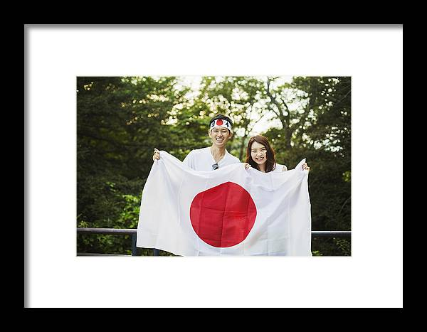 Man Wearing Headband And Young Woman With Brown Hair And Face Paint Holding  Japanese Flag, Smiling At Camera  Framed Print