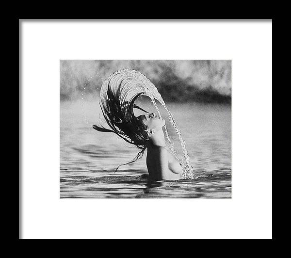 Model Framed Print featuring the photograph Marisa Berenson Flipping Her Hair In Water by Arnaud de Rosnay
