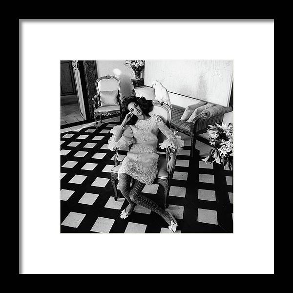 Accessories Framed Print featuring the photograph Marisa Berenson Wearing A Forneris Organza Dress by Henry Clarke