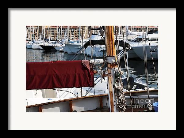 Maroon Sail Framed Print featuring the photograph Maroon Sail by John Rizzuto