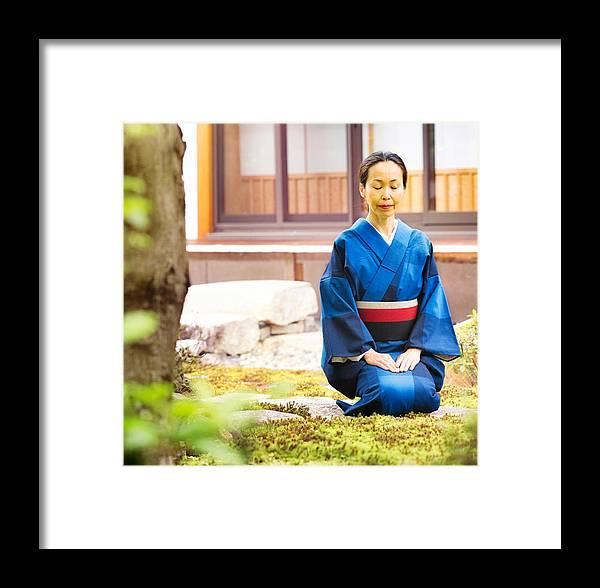 Mature Japanese Female Buddhist Meditating In Temple Garden Framed