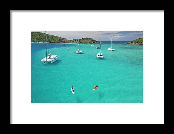 Scenics Framed Print featuring the photograph Men Doing Water Activities by Karl Weatherly