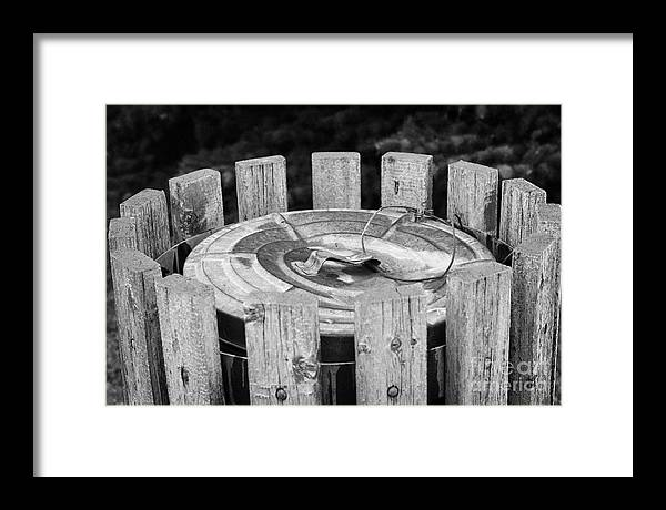 Metal Framed Print featuring the photograph metal public garbage bin with wire lid strap Saskatchewan Canada by Joe Fox