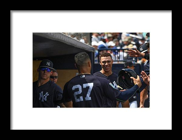 People Framed Print featuring the photograph Miami Marlins v New York Yankees by Mark Brown