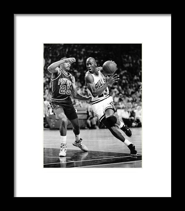 07e04dc206a Classic Framed Print featuring the photograph Michael Jordan Driving To The  Basket by Retro Images Archive
