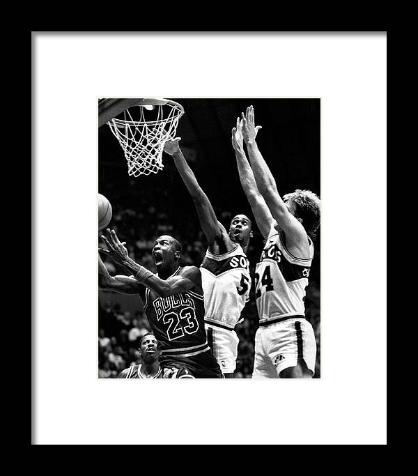d0b09b8cebf Classic Framed Print featuring the photograph Michael Jordan Going For A  Hard Layup by Retro Images