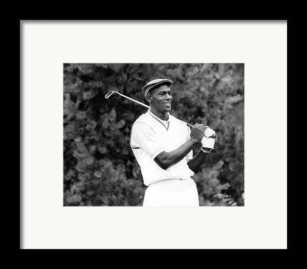 Classic Framed Print featuring the photograph Michael Jordan Playing Golf by Retro Images Archive