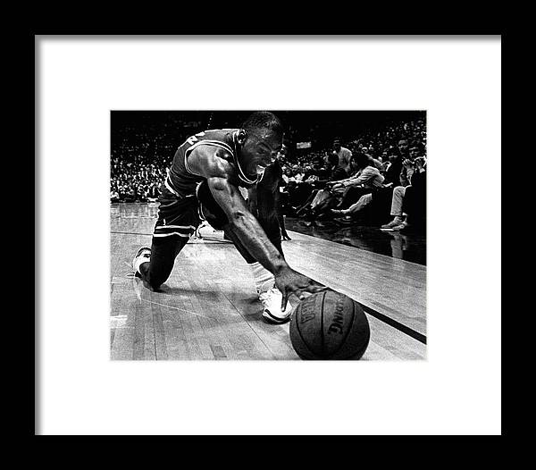 8606b7ef4f2 Classic Framed Print featuring the photograph Michael Jordan Reaches For  The Ball by Retro Images Archive