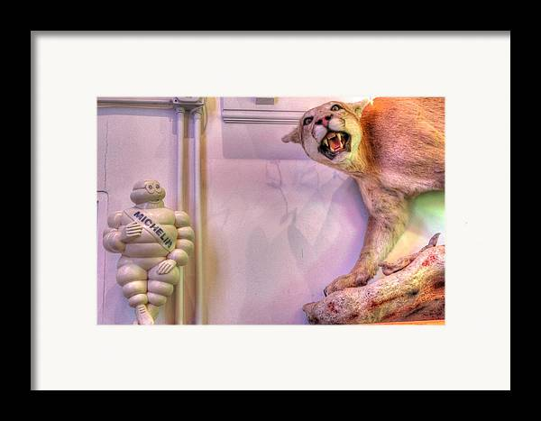 Michelin Man Framed Print featuring the photograph Michelin Man by Jane Linders