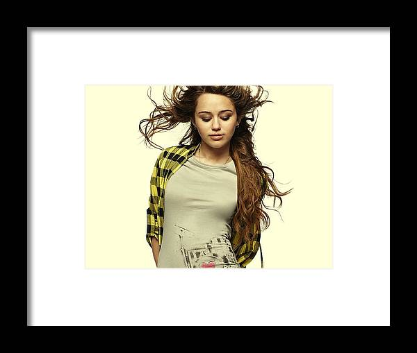 Miley Ray Cyrus Framed Print featuring the photograph Miley Cyrus by Movie Poster Prints