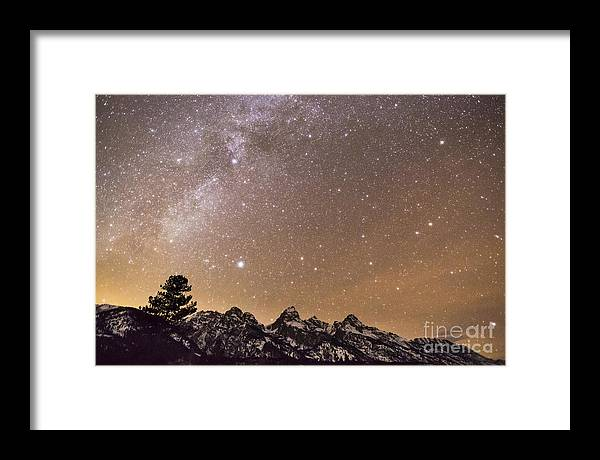 Clouds Framed Print featuring the photograph Milky Way Galaxy Over Teton Mountains by Mike Cavaroc