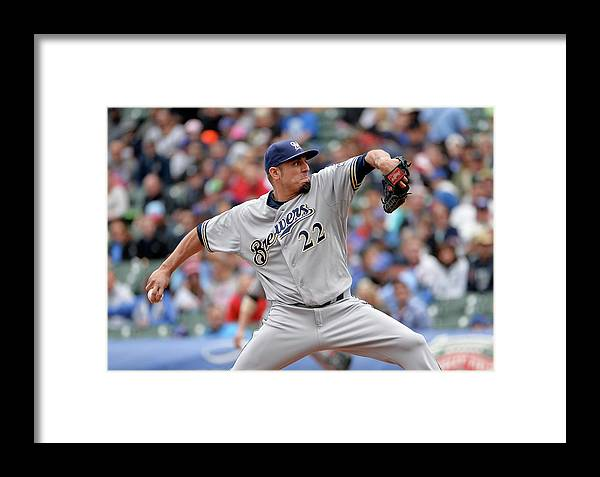 Baseball Pitcher Framed Print featuring the photograph Milwaukee Brewers V Chicago Cubs by Brian Kersey
