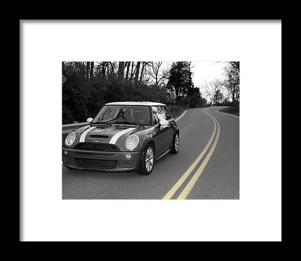 Black & White Framed Print featuring the photograph Mini-cooper Car Driving On Double Yellow Country Road by Nicole Berna