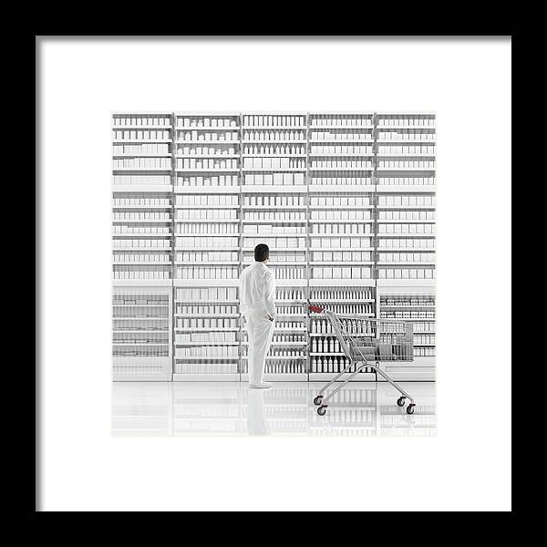 Internet Framed Print featuring the photograph Mixed Race Man Shopping On White by Colin Anderson Productions Pty Ltd