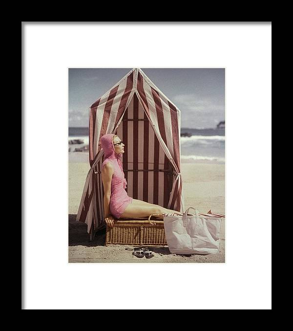 Fashion Framed Print featuring the photograph Model In Pink Swimsuit With Tent On Beach by Louise Dahl-Wolfe