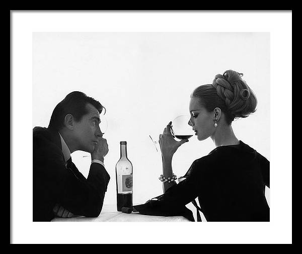 Man Gazing at Woman Sipping Wine by Bert Stern