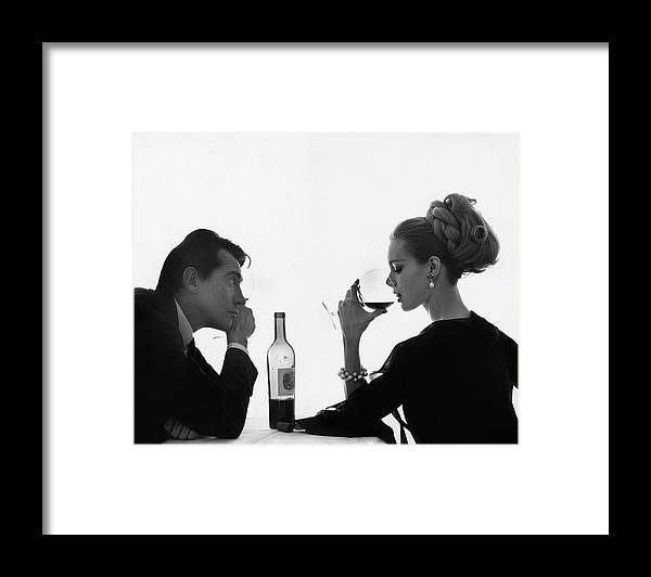 Entertainment Framed Print featuring the photograph Man Gazing at Woman Sipping Wine by Bert Stern