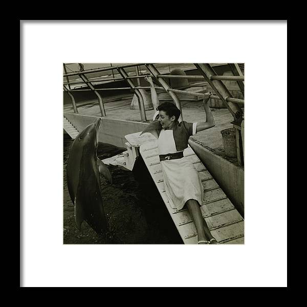 Accessories Framed Print featuring the photograph Model Wearing A Cannon Outfit By A Dolphin by Toni Frissell