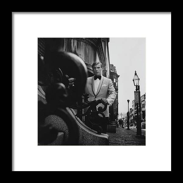 Exterior Framed Print featuring the photograph Model Wearing A Formal Craft Suit by Leonard Nones
