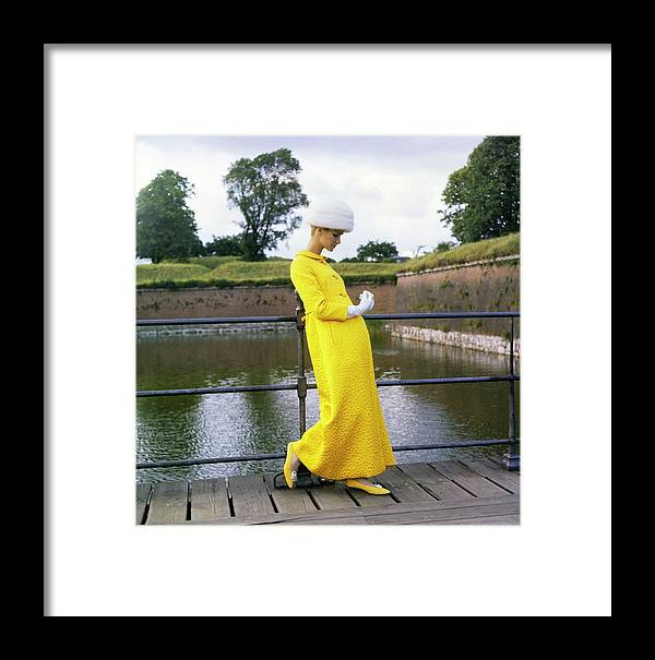 Fashion Framed Print featuring the photograph Model Wearing A Mollie Parnis Coat by Horst P. Horst