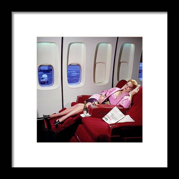 Indoors Framed Print featuring the photograph Model Wearing Pink Jacket On Airplane by Horst P. Horst