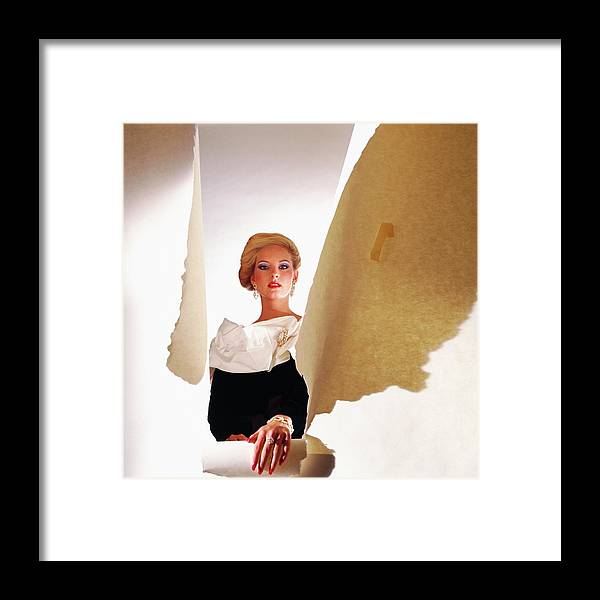 Studio Shot Framed Print featuring the photograph Model Wearing Satin Collar Behind Ripped Paper by Horst P. Horst