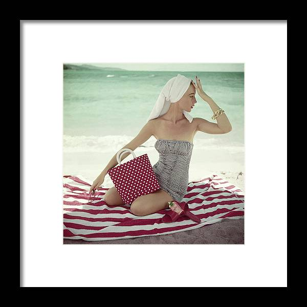 Fashion Framed Print featuring the photograph Model With A Polka Dot Bag On A Beach by Roger Prigent