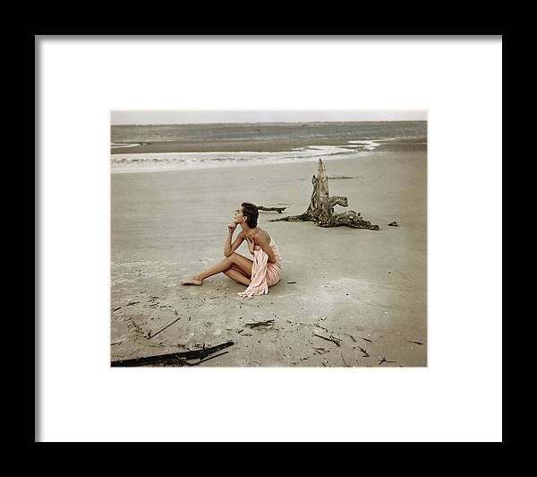 One Person Framed Print featuring the photograph Model Wrapped In A Pink Towel On The Beach by Frances McLaughlin-Gill