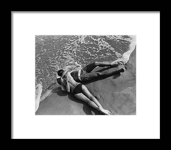Model Framed Print featuring the photograph Models Embracing On A Beach by Mark Patiky