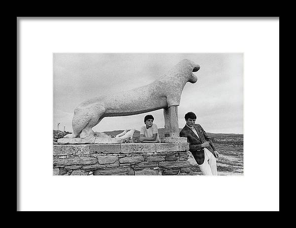 Fashion Framed Print featuring the photograph Models Posing By A Sculpture Of A Lion by Leonard Nones