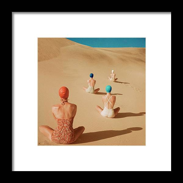 Fashion Framed Print featuring the photograph Models Sitting On Sand Dunes by Clifford Coffin