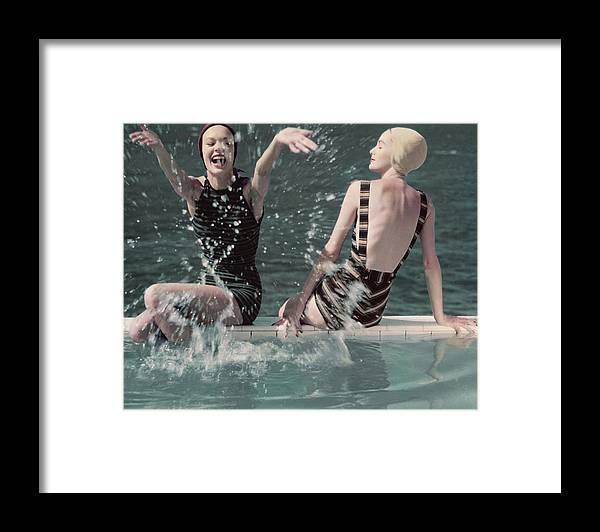 Two People Framed Print featuring the photograph Models Splashing Water While Sitting On The Edge by Frances McLaughlin-Gill