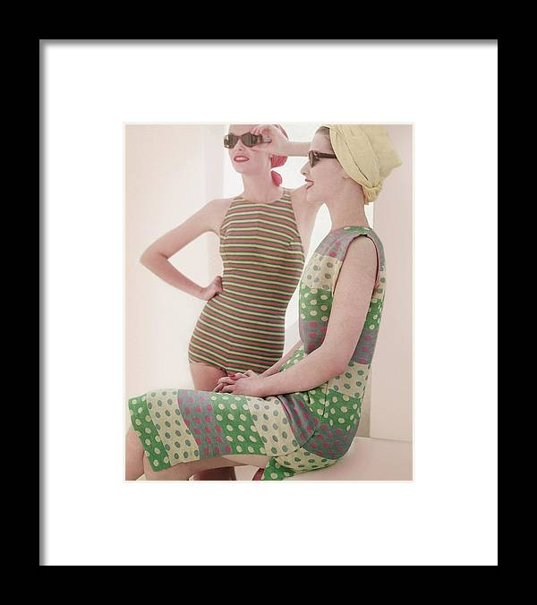 Studio Shot Framed Print featuring the photograph Models Wearing Swimwear And Dress by Horst P. Horst