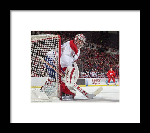 Following Framed Print featuring the photograph Montreal Canadiens V Detroit Red Wings by Dave Reginek